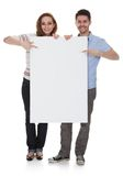 Young couple holding blank placard Royalty Free Stock Photos