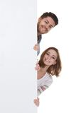 Young couple holding blank placard Royalty Free Stock Image