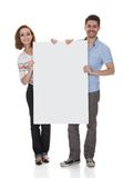 Young couple holding blank placard Royalty Free Stock Photo