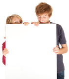 Young couple holding blank poster Royalty Free Stock Image
