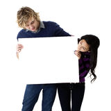 Young couple holding a blank sign Stock Photos