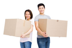 Young couple holding cardboard boxes Royalty Free Stock Photography