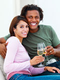 Young couple holding champagne glasses Stock Image