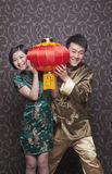 Young Couple Holding Chinese Lantern in Traditional Clothing Stock Photography