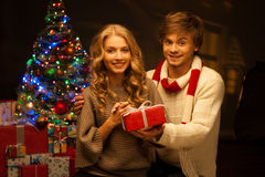 Young couple holding christmas gift Stock Photos
