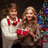 Young couple holding christmas gift Stock Image