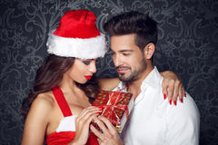 Young couple holding christmas gift Royalty Free Stock Image