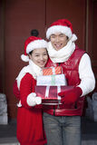 Young couple holding Christmas Gifts Royalty Free Stock Photo