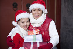 Young couple holding Christmas Gifts Royalty Free Stock Image