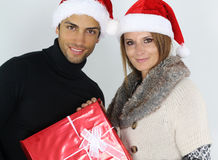 Young couple holding a Christmas present Royalty Free Stock Photo