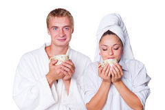 Young couple holding cup of tea Stock Photos