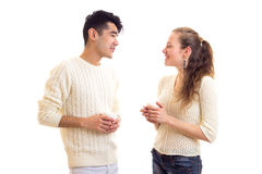 Young couple holding cups and talking Stock Images
