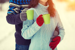 Young couple holding cups with tea Stock Image