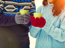 Young couple holding cups with tea Royalty Free Stock Image