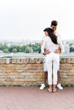 Young couple holding each other around waist Royalty Free Stock Photo