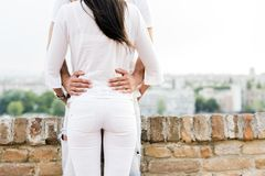 Young couple holding each other around waist. And being close to each other Royalty Free Stock Photography