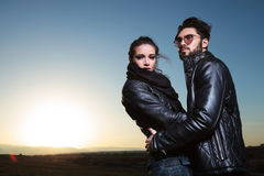 Young couple holding each other close. In the dawn, outdoor picture Royalty Free Stock Images