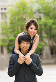 Young Couple Holding Each Other Outdoors Royalty Free Stock Photo
