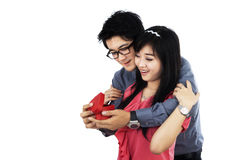Young couple holding a gift box Stock Image