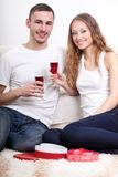 Young couple  holding glasses with wine Stock Images