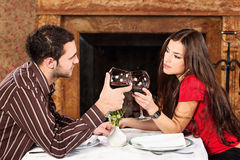 Couple holding glasses of wine Stock Images