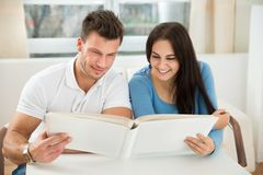 Young couple holding green house model Stock Image
