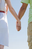 Young couple holding hands. Closeup image of a young couple holding hands stock photography