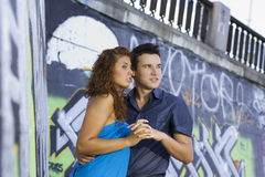 Young couple holding hands stock photography