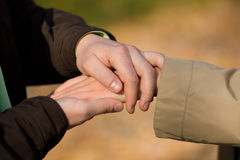 A young couple is holding hands royalty free stock photo
