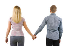 A young couple holding hands, back to camera Stock Photos