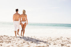Young couple holding hands Royalty Free Stock Photos