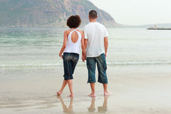 Young couple holding hands on the beach Royalty Free Stock Photo