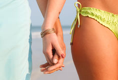 Young Couple Holding Hands on the Beach Royalty Free Stock Images