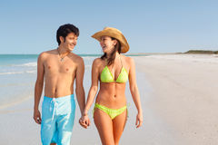 Young Couple Holding Hands on the Beach Royalty Free Stock Photos
