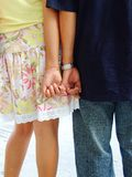 A young couple holding hands. Close-up image of a young couple holding hands Royalty Free Stock Photos