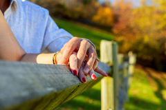 Young couple holding hands closeup while outdoors a park. Young couple holding hands closeup while outdoors in a park Stock Photo