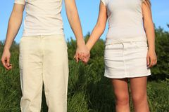 Young couple holding hands each other Stock Photo