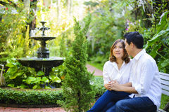 Young couple holding hands in the garden Stock Photography