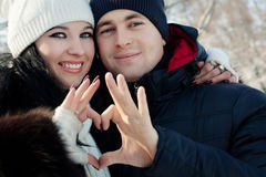 Young couple holding hands heart Royalty Free Stock Photography