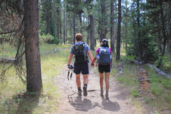 Young couple holding hands on hike Stock Photos
