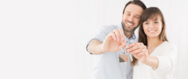 A young couple holding hands house key. Stock Image