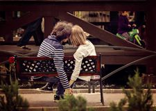 Young Couple Holding Hands On Bench In Park. Royalty Free Stock Photos