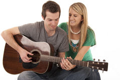 Young couple holding hands playing guitar Stock Photos