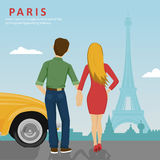 Young couple holding hands standing next to yellow car looking at Eiffel Tower in Paris Royalty Free Stock Images