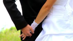 Young couple holding hands standing together in park stock video footage