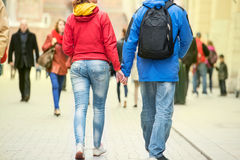 Young couple holding hands. On the street Royalty Free Stock Photography
