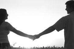 Young couple holding hands on sunny summer day Royalty Free Stock Images