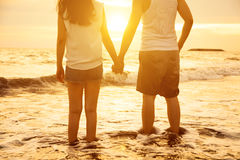 Young couple holding hands at sunset Stock Image