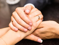 Young couple are holding hands. On the table Royalty Free Stock Image