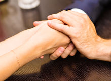 Young couple are holding hands Stock Photos